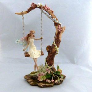 Fairy Swinging on a Tree Branch
